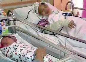 ??  ?? A teacher, who was stabbed by her husband on Friday, and her newborn son at Putrajaya Hospital on Saturday.