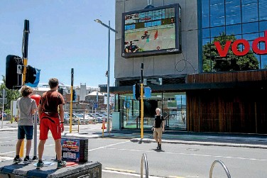 ?? PHOTO: STACY SQUIRES/FAIRFAX NZ ?? The Super Street Arcade game was installed on Tuam St opposite the Vodafone building in central Christchurch on Thursday.