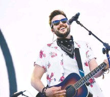 ?? KEVIN WINTER/GETTY IMAGES FOR STAGECOACH ?? Country musician Jackie Lee, 26, documented his struggle with cancer in a music video that was released this week.