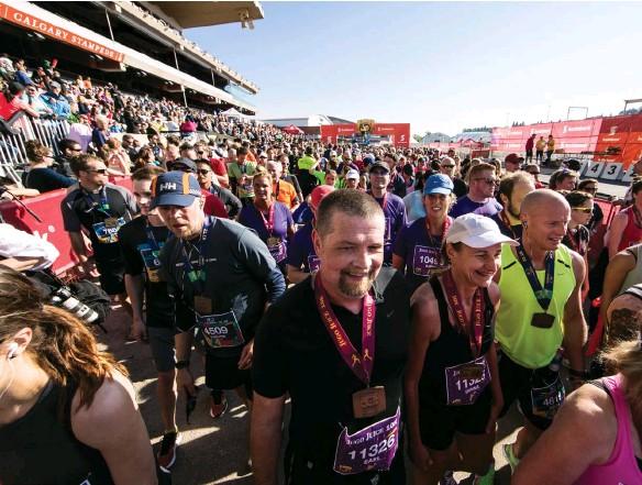 ??  ?? ABOVE AND RIGHT Scotiabank Calgary Marathon