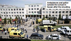 ??  ?? Ambulances and police outside the school in Kazan after the shooting