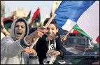 ?? By Patrick Baz, AFP/Getty Images ?? In Benghazi: Rebels show support for no-fly zone.