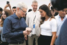 ?? Marcio Jose Sanchez / Associated Press ?? Apple CEO Tim Cook (left) and soccer player Alex Morgan discuss the new Apple Watch 4 that has a focus on health.