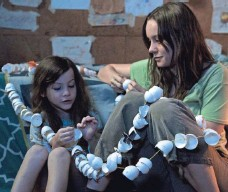 ?? PHOTOS BY CAITLIN CRONENBER AND GEORGE KRAYCHYK, A24 ?? Jack (Jacob Tremblay) and Ma (Brie Larson) are cut off from the world before they finally manage to escape.