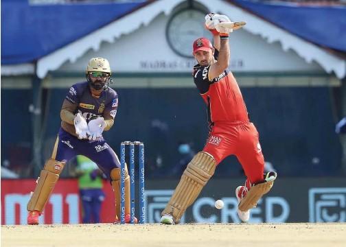 ?? Courtesy: IPL Twitter ?? ↑ Glenn Maxwell of Royal Challengers Bangalore plays a shot against Kolkata Knight Riders during their IPL match at the MA Chidambaram Stadium in Chennai on Sunday.