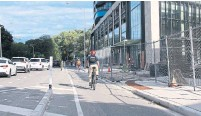 ?? JACK LAKEY ?? For months, the cycling lane on the south side of Bloor Street was closed to apply the finishing touches on a new building. It was reopened after an Aug. 13 Fixer column about the problem.