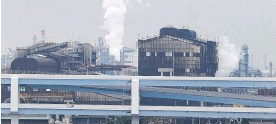 ?? Photo / AP ?? Reducing use of fossil fuels, such as produced at this oil refinery in Kawasaki, are part of the ambitious plan.