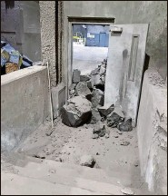 ?? Photo taken by Gopher worker ?? Clusters of lead-containing rock block a door inside the factory in this April 2021 photograph.