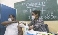 ?? SUMIT DAYAL / BLOOMBERG ?? A health workers administers a dose of the Covishield vaccine, manufactured by the Serum Institute of India, at a vaccination centre in New Delhi.