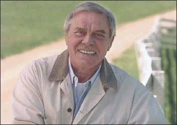 """?? MARK HUMPHREY/AP PHOTO ?? In this April 1996 file photo, country music legend Tom T. Hall, poses for a photo at his home in Franklin, Tenn. Hall, who composed """"Harper Valley P.T.A."""" and sang about life's simple joys as country music's consummate blue collar bard, has died."""