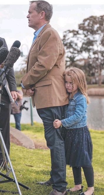 ??  ?? DROP IN POPULARITY: Opposition Leader Bill Shorten with daughter Chloe yesterday in Moonee Ponds, Victoria. Picture: Christopher Chan