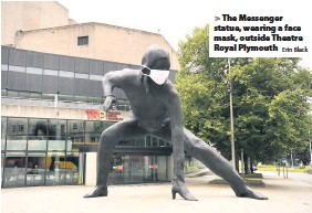 ?? Erin Black ?? The Messenger statue, wearing a face mask, outside Theatre Royal Plymouth