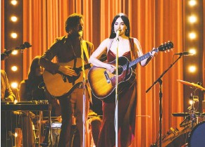 """?? CHARLES SYKES/INVISION/ASSOCIATED PRESS ?? TOP: Baltimore's Serpentwithfeet (Josiah Wise), in a November portrait while touring in support of his top album """"Soil."""" ABOVE: Kacey Musgraves performs a song from her sparkling """"Golden Hour"""" at the 52nd annual CMA Awards in November."""