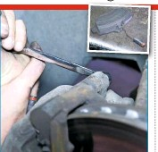 ??  ?? 20 RE­MOVE BRAKE PADS Un­plug the brake sen­sor wire (if ap­pro­pri­ate), then undo the two rear caliper bolts; they should be 13mm items, but one here was 12mm. Lift off the caliper, re­move the pads, then carry on with fur­ther clean­ing, such as turn­ing the disc rim against a screw­driver blade to re­move any loose cor­ro­sion.