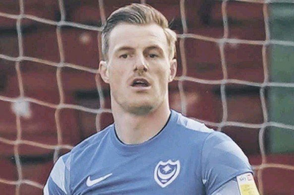 ??  ?? Craig MacGillivray, above, and Jack Whatmough, right, have been two of Pompey's top performers this season, although the latter is out of contract at Fratton Park this summer and facing an