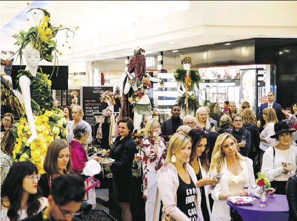 ?? PHOTOS: CODIE MCLACHLAN ?? People check out decorated mannequins during Fleurs de Villes at Southgate Centre. The event runs until Sunday.