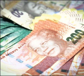 ?? PHOTO: BLOOMBERG ?? Rand banknotes arranged for display in this file photo. The Competition Commission alleges that 14 banking entities have colluded to manipulate the value of the rand.