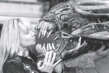 """?? JOHNNY EGGIT/AGENCE FRANCE-PRESSE/GETTY IMAGES ?? Sculpture artist Emma Pryke gets close to the monster from the """"Alien"""" film franchise, which got its start 40 years ago."""