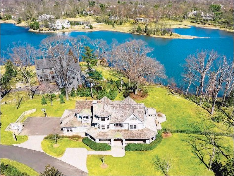?? Contributed photo ?? This spacious home, with its private natural waterfront setting filled with abundant wildlife, features 16 rooms, including a large custom kitchen, and offers beautiful flow throughout.