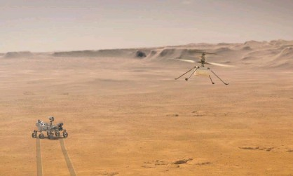 ?? Photograph: Nasa/JPL-Caltech/PA ?? An artist's impression of how the Ingenuity helicopter may look when it lifts off into Martian skies.