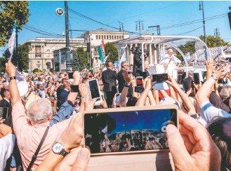 """?? JANOS KUMMER/GETTY IMAGES ?? Pope Francis in the popemobile on Sunday in Budapest. The pontiff asked Hungary to """"extend its arms toward everyone,"""" as he appeared to critique its anti-migrant policies."""
