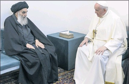 ?? THE ASSOCIATED PRESS ?? Pope Francis meets Saturday with Iraq's leading Shiite cleric, Grand Ayatollah Ali al-Sistani in Najaf, Iraq. The closed-door meeting was expected to touch on issues plaguing Iraq's Christian minority.