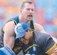 ??  ?? IT'S TIME: Glenn Hall tackles Jason Taumalolo at training.