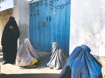 ??  ?? Women who fled clashes wait outside a government office in central Kandahar city hoping to collect aid for displaced civilians.