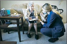 ?? Al Seib Los Angeles Times ?? NURSE Bella Pashabezyan, right, fills out forms with Hasmik Eskandarian after vaccinating the 86-year-old against COVID-19 last month in Glendale.