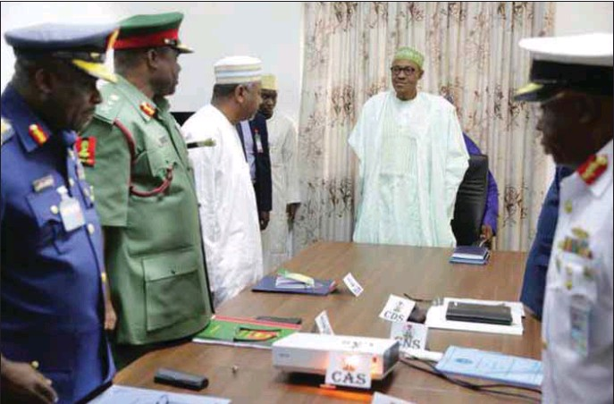 Image result for Nigerians must go to bed with their eyes close - Buhari tells Security Chiefs