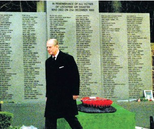 ??  ?? Lockerbie visit The Duke of Edinburgh after placing a red poppy wreath with a message from himself and the Queen at the Garden of Remembrance at Dryfesdale Cemetery in 1998 on the 10th anniversary of the Pan Am disaster.