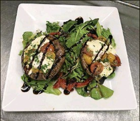 ?? CONTRIBUTED PHOTOS ?? The Carillon Caprese Portobello is among the items on The Dayton Club's new menu. The restaurant used to be named the Dayton Racquet Club.
