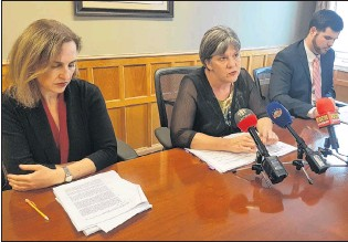 ?? JAMES MCLEOD/THE TELEGRAM ?? Lawyers Kathleen O'reilly, Lynn Moore and Jim Locke speak to reporters Wednesday about a class-action lawsuit alleging sexual and physical abuse of children in provincial government custody dating back to the 1950s.