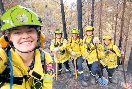 ?? Photo/ Supplied ?? Tash Hill (front) with members of the Kohi Rural Fire Force.