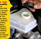 ??  ?? 13 CHECK BRAKE FLUID The brake and clutch fluid reser­voir is on the right-hand side of the bulk­head, un­der a large cover. You need to rotate the two fas­ten­ers an­ti­clock­wise, after which you can lift the cover for ac­cess to the reser­voir. It has 'MIN' and 'MAX' marks on the cas­ing, but we rec­om­mend using an elec­tronic fluid checker.