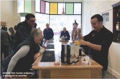 ??  ?? Distiller Nick Secker prepares a tasting for a customer