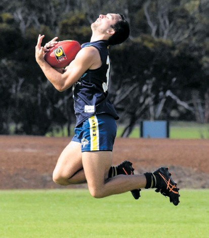 ?? Pictures: Taj Stubber ?? Storm's Max Baker takes a strong mark.
