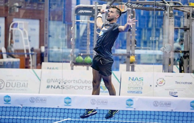 ??  ?? ↑ Action from Golden Category match of NAS Padel Championship.