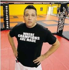 ?? RICHARD MARJAN/STARPHOENIX ?? Trainer-promoter Troy Scheer in the octagon at his martial arts school in Saskatoon on Tuesday.