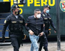 ?? PHOTO: REUTERS ?? A man is detained by police after they raided a nightclub for hosting a party in violation of Covid19 restrictions in Lima recently. Peru has one of the highest death rates from the disease.