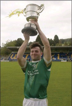 ??  ?? St Nicholas captain Tadgh McCarthy lifts the MFC 'A' cup into the air after their dramatic victory over Blessington in Aughrim.