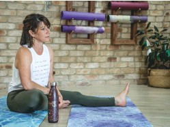 ??  ?? Monica Mudge, founder of environmental charity Treading Lightly, here at her Milton yoga studio, believes a big review is needed into how bushfires get handled in the future.