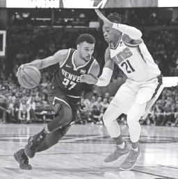 ?? ISAIAH J. DOWNING/USA TODAY SPORTS ?? Suns forward Richaun Holmes (21) guards the Nuggets' Jamal Murray on Saturday in Denver.