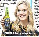??  ?? CHEERS Poppy raises bottle