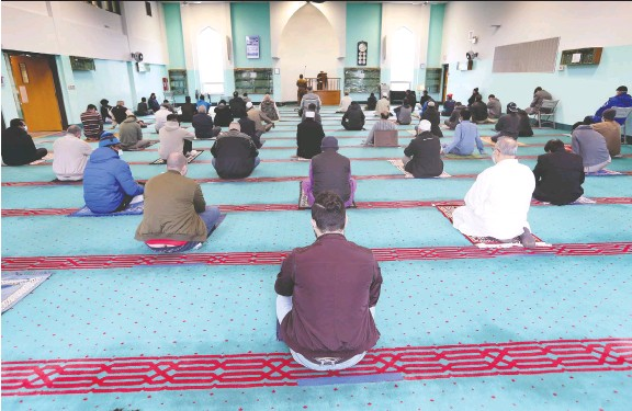 ?? DAN JANISSE ?? Members of the local Muslim community participate in Ramadan prayers on Friday at the Windsor Mosque. The mosque is open but on a very limited basis.