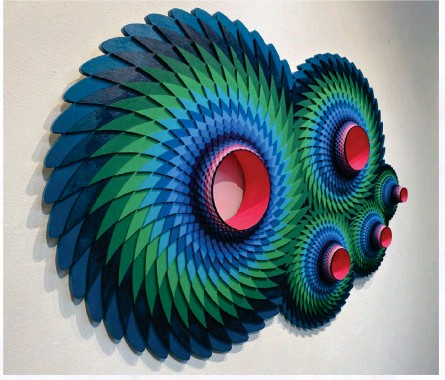 ??  ?? Left: Point Conjunction, 2020, Acrylic on Laser Cut wood, 27 x 36.5 x 4 in. © Christine Romanell. All rights reserved.