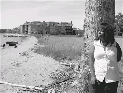 ??  ?? Deni Henson, who is creating a documentary about Carr's Beach and Sparrow's Beach in Annapolis, visited the area that was once Sparrow's Beach, but she could not go to Carr's. The condos in the background sit where the popular entertainment destination...