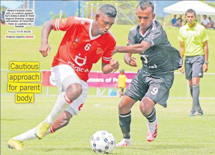 ?? Picture: FIJI FA MEDIA. ?? Rewa's Kishan Sami, left, in control against Ba's Abbu Zahid in their Digicel Premier League encounter at Churchill Park in Lautoka on Sunday. More reports INSIDE