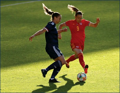 ??  ?? Brianna Westrup and Wales' Kayleigh Green battle for the ball during Scotland's 1-0 win