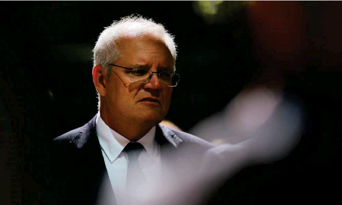 ?? Photograph: Steven Saphore/AFP/Getty Images ?? Prime minister Scott Morrison said on Sunday that while he hoped all eligible Australians could have at least a first dose of a Covid vaccination by the end of the year, there were no guarantees.